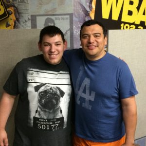 Zach with comedian Carlos Mencia